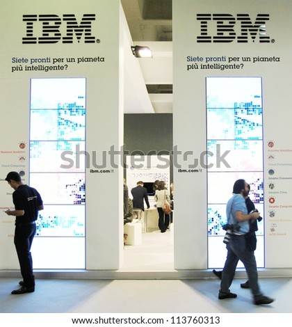 MILAN, ITALY - OCT. 19: People visiting IBM technologies area during SMAU, international fair of business intelligence and information technology October 19, 2011 in Milan, Italy. - stock photo
