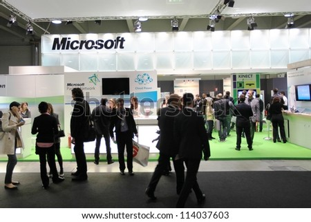 MILAN, ITALY - OCT. 19: People visiting Microsoft technologies area during SMAU, international fair of business intelligence and information technology October 19, 2011 in Milan, Italy. - stock photo
