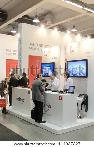 MILAN, ITALY - OCT. 19: People visiting Olivetti technologies area during SMAU, international fair of business intelligence and information technology October 19, 2011 in Milan, Italy. - stock photo