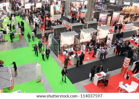 MILAN, ITALY - OCT. 19: View of people visiting technologies exhibition area during SMAU, international fair of business intelligence and information technology October 19, 2011 in Milan, Italy. - stock photo