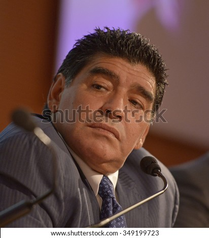 MILAN, ITALY-OCTOBER 17, 2013: argentinian former soccer player Diego Armando Maradona, one of the most famous soccer player ever, during a press conference, in Milan. - stock photo