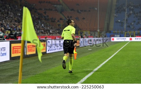 MILAN, ITALY-OCTOBER 19,2014: border line referee assistant in action during the Italian serie A night soccer match FC Internazionale vs  Napoli at the san siro stadium, in Milan. - stock photo