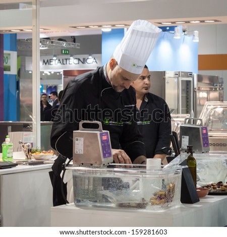 MILAN, ITALY - OCTOBER 18: Cook at Host 2013, international exhibition of the hospitality industry on OCTOBER 18, 2013 in Milan. - stock photo