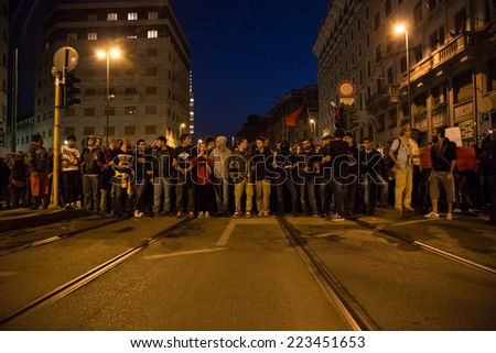 MILAN, ITALY - OCTOBER 11: Demonstrators protest in front of the Turkish consulate asking help for Kurdish people in Syria on OCTOBER 11, 2014 in Milan. - stock photo