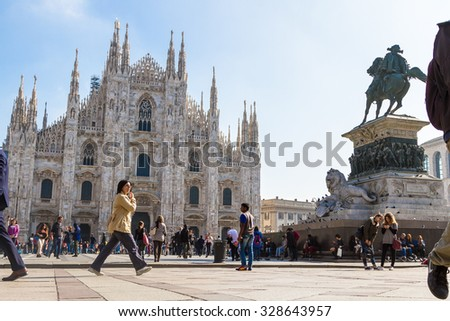 MILAN, ITALY - OCTOBER 10, 2015: Duomo di Milano (Milan Cathedral) and Piazza del Duomo in Milan, Italy. Milan's Duomo is the second largest Catholic cathedral in the world. - stock photo