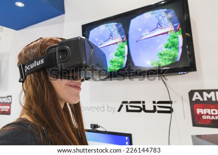 MILAN, ITALY - OCTOBER 24: Girl tries Oculus headset at Games Week 2014, event dedicated to video games and electronic entertainment on OCTOBER 24, 2014 in Milan. - stock photo