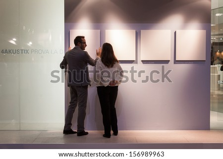 MILAN, ITALY - OCTOBER 3: People visit Made expo, international architecture and building trade show on OCTOBER 3, 2013 in Milan. - stock photo