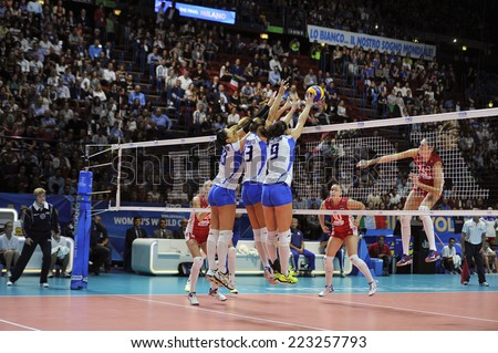 MILAN, ITALY-OCTOBER 10, 2014: players in action during the indoor female volleyball match Italy vs Russia of the Volleyball World Cup, in Milan. - stock photo