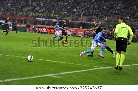 MILAN, ITALY-OCTOBER 19,2014: players Juan Jesus and Jose' Maria Callejon in action during the Italian serie A night soccer match FC Internazionale vs  Napoli at the san siro stadium, in Milan. - stock photo