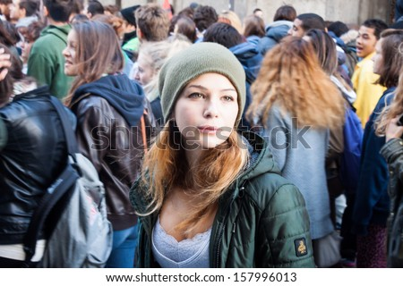 MILAN, ITALY - OCTOBER 11: Secondary school students march in the city streets to protest against money cuts in the public school on OCTOBER 11, 2013 in Milan. - stock photo
