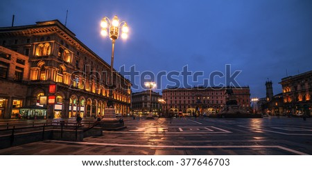Milan, Italy: Piazza del Duomo, Cathedral Square in the sunrise. Monument to King Victor Emmanuel II - stock photo