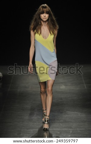 MILAN, ITALY - SEPTEMBER 18: A model walks the runway at the Angelo Marani - Show during Milan Fashion Week Womenswear Spring 2015 on Septmber 18, 2014 in Milan, Italy. - stock photo