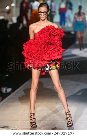 MILAN, ITALY - SEPTEMBER 18: A model walks the runway during the DSquared2 show as a part of Milan Fashion Week Womenswear Spring/Summer 2015 on September 18, 2014 in Milan, Italy. - stock photo