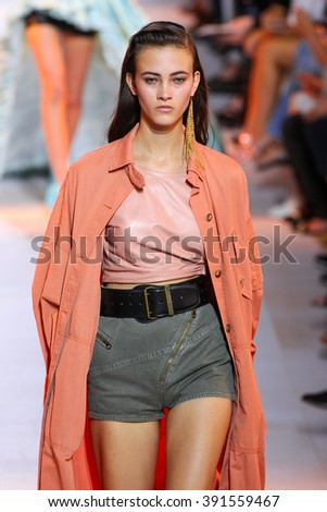 MILAN, ITALY - SEPTEMBER 26: A model walks the runway during the Roberto Cavalli fashion show as part of Milan Fashion Week Spring/Summer 2016 on September 26, 2015 in Milan, Italy. - stock photo