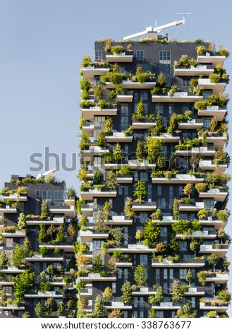 """MILAN, ITALY - SEPTEMBER 19: """"Bosco Verticale"""" (""""Vertical Forest"""") is a pair of two residential towers in the district of Porta Nuova, Milan; they host hundreds of trees and plants in the balconies. - stock photo"""