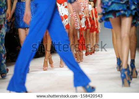 MILAN, ITALY - SEPTEMBER 29: Models walk during the Fashion week in Milan September, 29 2009.  - stock photo