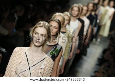 MILAN, ITALY - SEPTEMBER 20: Models walk the runway during Bottega Veneta show as a part of Milan Fashion Week Womenswear Spring/Summer 2015 on September 20, 2014 in Milan, Italy - stock photo