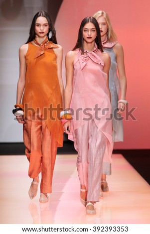 MILAN, ITALY - SEPTEMBER 25: Models walk the runway during the Emporio Armani show as a part of Milan Fashion Week Spring/Summer 2016 on September 25, 2015 in Milan, Italy.  - stock photo