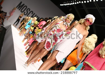 MILAN, ITALY - SEPTEMBER 18: Models walk the runway finale during the Moschino show as part of Milan Fashion Week Womenswear Spring/Summer 2015 on September 18, 2014 in Milan, Italy.  - stock photo