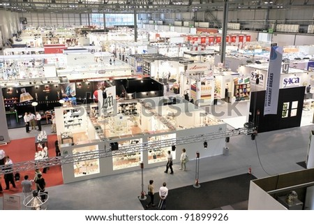MILAN, ITALY - SEPTEMBER 09: Panoramic view of architecture and interiors design pavilions visited by people at Macef, International Home Show Exhibition on September 09, 2011 in Milan, Italy. - stock photo