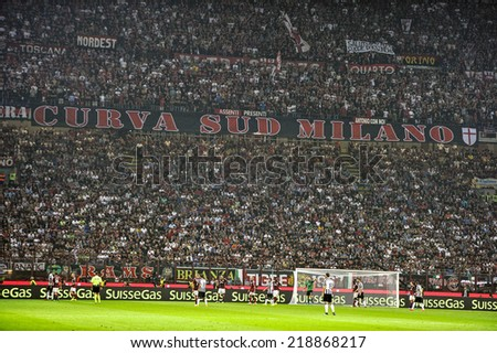 MILAN, ITALY-SEPTEMBER 20, 2014: soccer fans gathering at the San Siro stadium, during the professional serie A soccer match AC Milan vs Juventus, in Milan. - stock photo