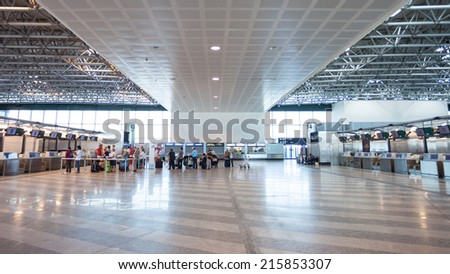 MILAN - JUNE 08 2014: People waiting Malpensa Airport on JUNE 08, 2014 in Milan. Malpensa was the 21st busiest airport in Europe handling 18,537,301 passengers in 2012 and 17,955,075 in 2013 - stock photo