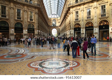 MILAN - OCTOBER 7: Vittorio Emmanuele II shopping gallery on October 7, 2010 in Milan, Italy. Inaugurated in 1865, the gallery claims to be the oldest shopping center worldwide. - stock photo