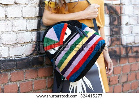 MILAN - SEPTEMBER 24: Negin Mirsalehi poses for photographers with Fendi backpack before Fendi show during Milan Fashion Week Day 2, Spring / Summer 2016 street style on September 24, 2015 in Milan. - stock photo
