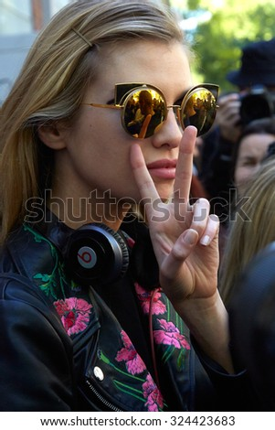 MILAN - SEPTEMBER 24: Stella Maxwell poses for photographers after Fendi show during Milan Fashion Week Day 2, Spring / Summer 2016 street style on September 24, 2015 in Milan. - stock photo