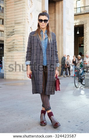 MILAN - SEPTEMBER 24: Woman poses for photographers before Cristiano Burani show during Milan Fashion Week Day 2, Spring / Summer 2016 street style on September 24, 2015 in Milan. - stock photo
