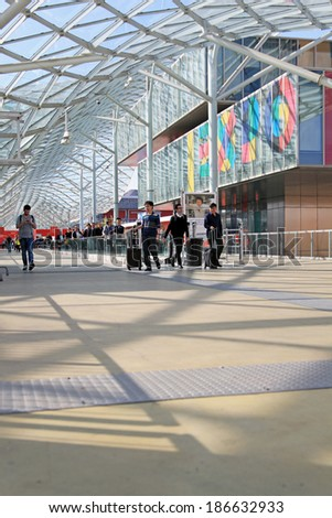 MILANO - APRIL 10, 2014: People walk to the entrance of Salone del Mobile, international home furnishing and accessories design exhibition in Milano, Italy.  - stock photo