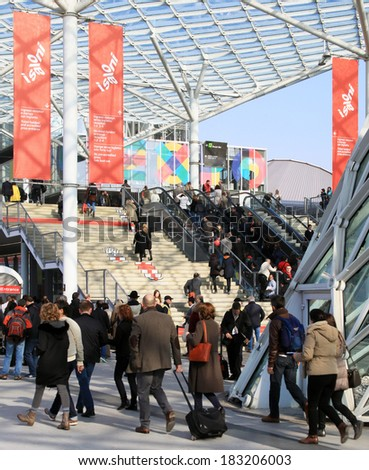 MILANO, ITALY - APRIL 10, 2013: People enter Salone del Mobile, international furnishing accessories exhibition at Rho Fiera Center in Milano, Italy.  - stock photo