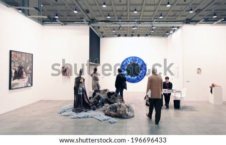MILANO, ITALY - APRIL 08, 2011: People visit paintings galleries during MiArt, international exhibition of modern and contemporary art in Milano, Italy - stock photo