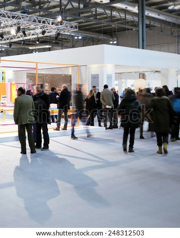 MILANO, ITALY - JANUARY 19, 2015: People visit HOMI, international fair exhibition of lifestyle and interior design architecture, last trade show before next EXPO in Milano, Italy. - stock photo