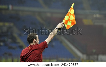 MILANO, ITALY-NOVEMBER 27, 2014: linesman holding a flag at san siro stadium during UEFA  cup soccer match FC Internazionale vs Dnipro, in Milan. - stock photo