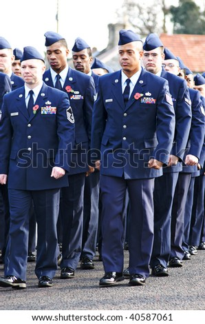 MILDENHALL, UK - NOVEMBER 8: US Air Force airmen marching during the remembrance sunday parade and ceremony on November 8, 2009 in Mildenhall, UK. - stock photo