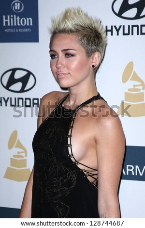 Miley Cyrus at the 2013 Clive Davis And Recording Academy Pre-Grammy Gala, Beverly Hilton Hotel, Beverly Hills, CA 02-09-13 - stock photo