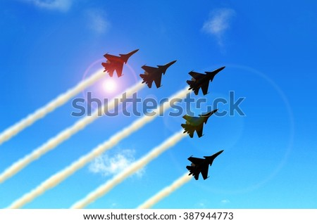Military aerobatic jets formation under blue sky during Air Show  - stock photo