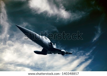 Military airplane on the speed in the sky - stock photo