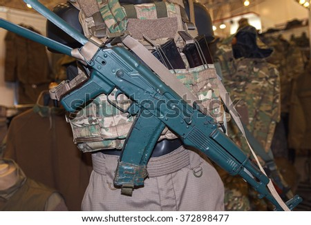 Military ammunition and assault rifle close-up. Weapons - stock photo