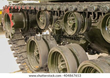 Military army tank wheels up close. - stock photo