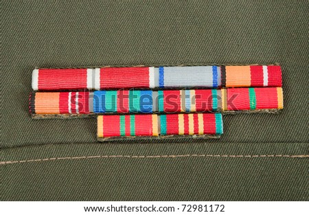Military awards on the green uniform - stock photo
