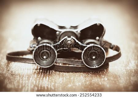 Military binoculars since World War II. Photos in retro style - stock photo
