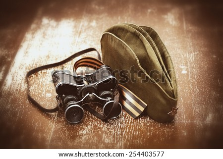 Military binoculars, soldier field cap, George Ribbon. Retro style for the holiday May 9 Victory - stock photo