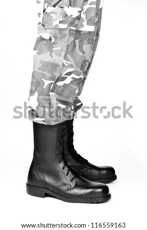 Military boots and pants on a white background - stock photo