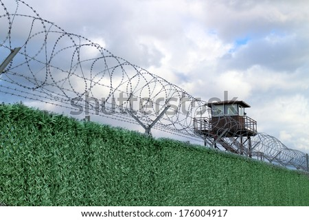 Military camp with fence and watchtower - stock photo