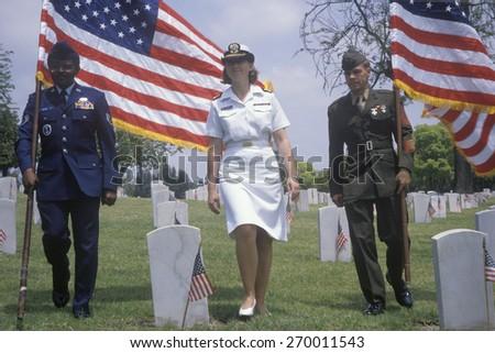 Military color guard at Veteran's Cemetery, Los Angeles, California - stock photo