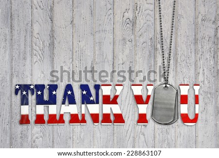 military dog tag thank you with flag font on weathered barn wood background  - stock photo