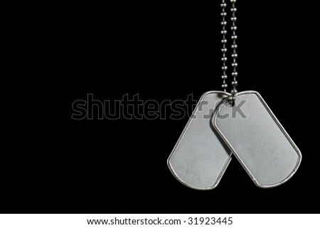 military dog tags on black - stock photo
