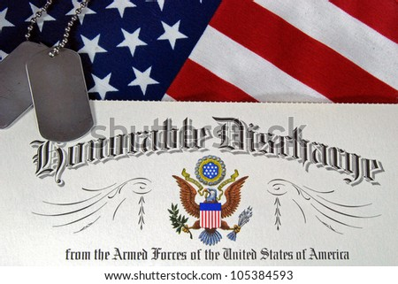 military dog tags with honorable discharge - stock photo